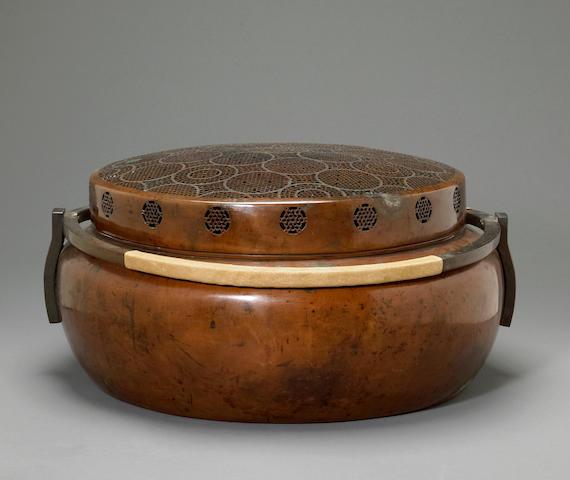 A large bronze hand warmer