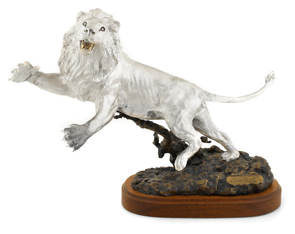 An American fine silver and patinated bronze figure of a leaping lion: Challenger by Douglas Van Howd, Auburn, CA, late 20th century