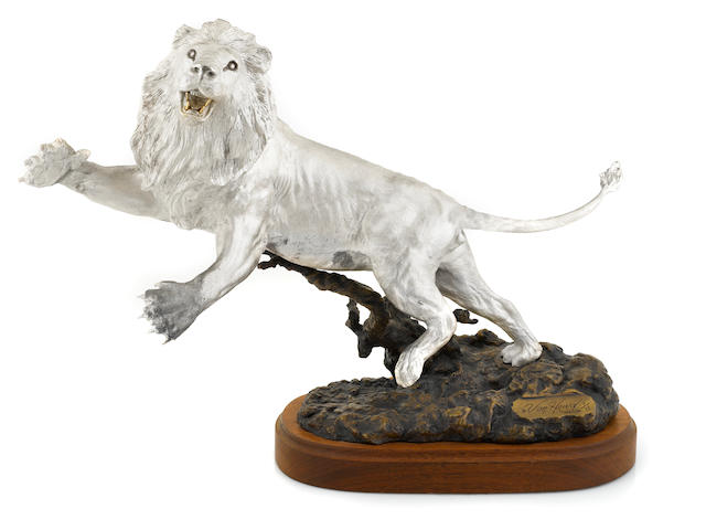 An American fine silver and patinated bronze figure of a leaping lion: Challenger Douglas Van Howd, Auburn, CA, late 20th century