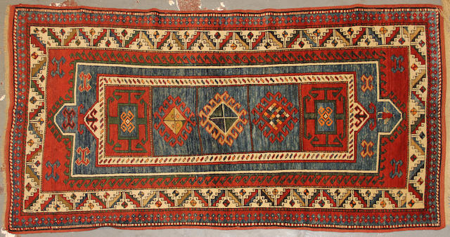 A Caucasian rug size approximately 4ft. x 7ft.