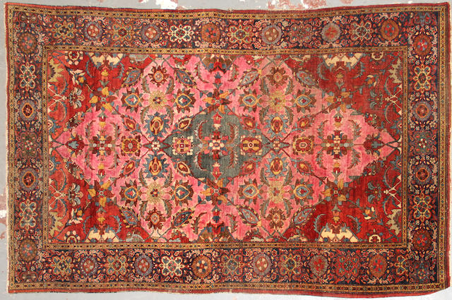 A Sarouk rug  size approximately 4ft. 1in. x 6ft. 6in.