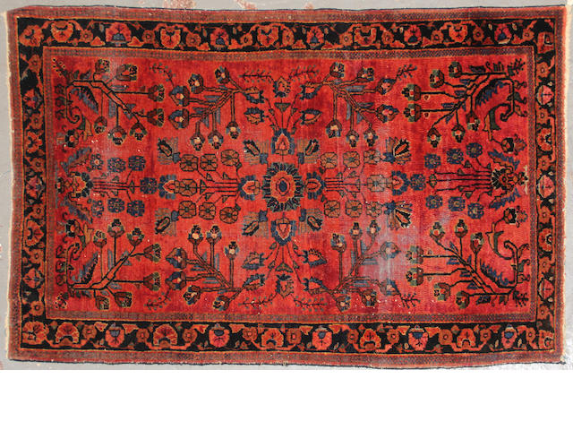 A Sarouk rug  size approximately 3ft. 1in. x 4ft. 9in.