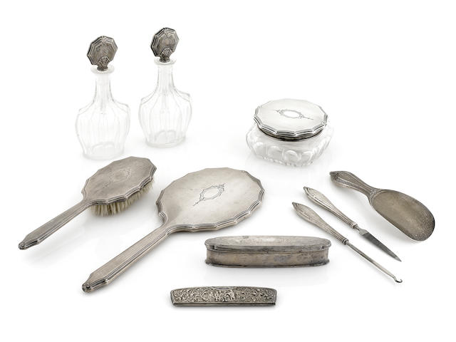 An assembled sterling silver and cut glass vanity set