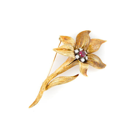 A diamond, red stone and 18k gold flower brooch,