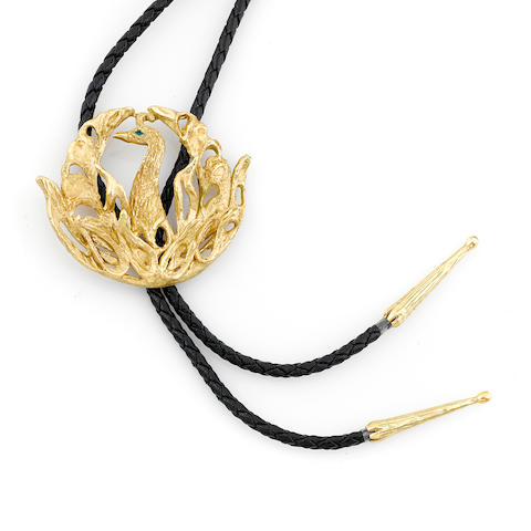 A gold and green stone bolo tie
