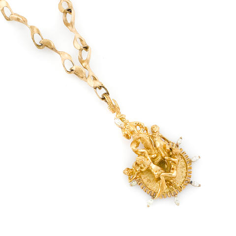 A gold and diamond figural pendant and heavy link chain necklace