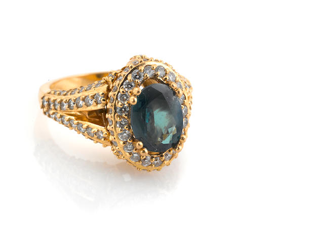A green stone, diamond and 18k gold ring