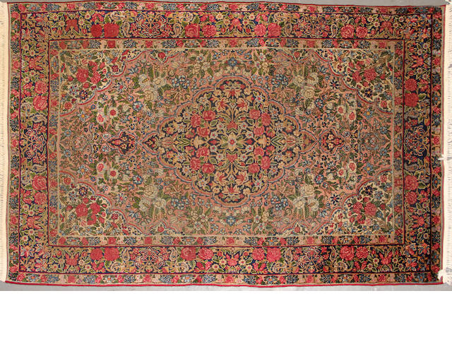 A Kerman rug size approximately 5ft. x 7ft.