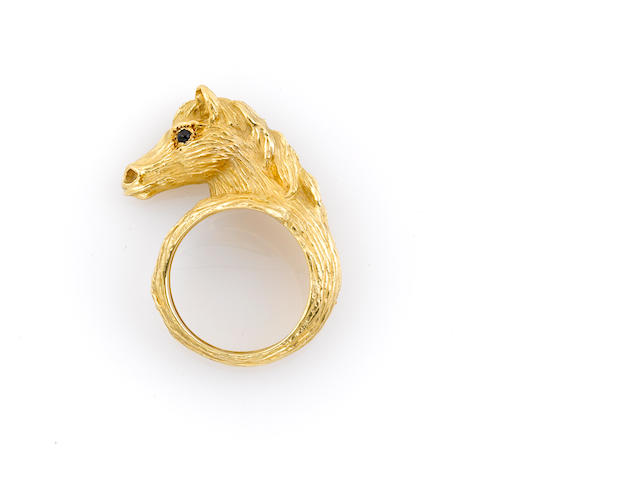 An 18k gold horse head ring with black-gem eyes, Van Cleef & Arpels