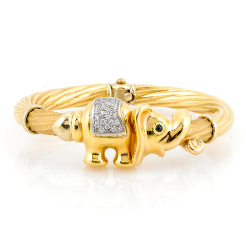 A diamond, black gem and 18k gold elephant motif bangle bracelet