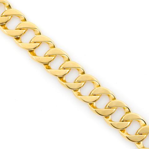 An 18k gold curb link bracelet