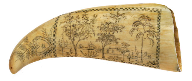 A scrimshaw whale's tooth<BR /> circa 1860 6-3/4 in. (17.1 cm.) length.