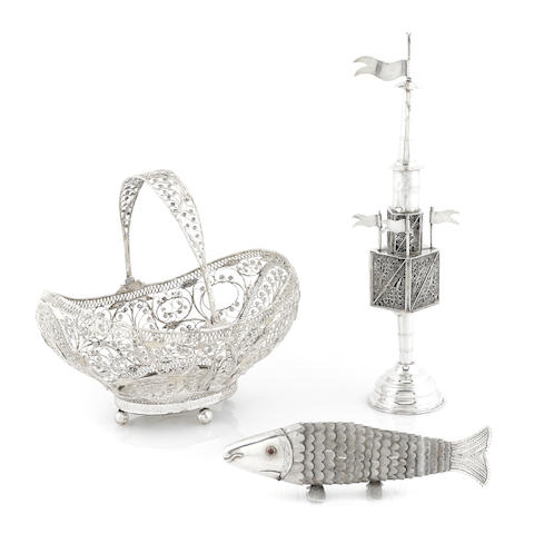 a group of Continental silver Judaica; a bon bon basket; a spice tower (one flag lacking) and an articulated fish form spice box