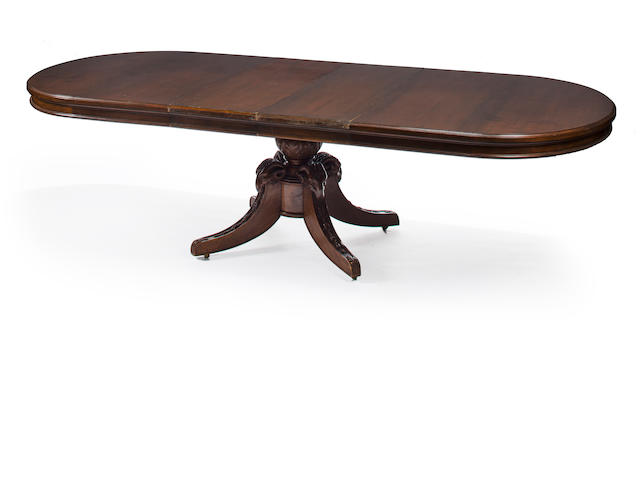 A late Victorian carved mahogany two pedestal extension dining table, late 19th / early 20th century, with four leaves, height 29 1/2in; length with two leaves 78in; depth 52in