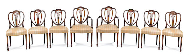 A set of eight George III style inlaid mahogany dining chairs, comprising two armchairs and six side chairs, early 20th century, height 38 1/2in; width 23in; depth of seat 20 1/2in