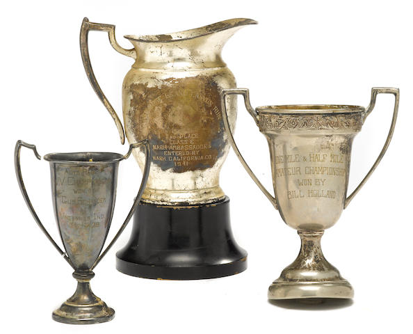 A lot of three racing trophies,