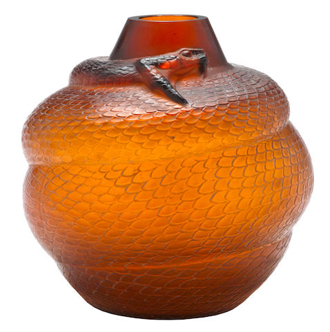 A 'Serpant' vase in deep amber glass by René Lalique, introduced April 24, 1924,