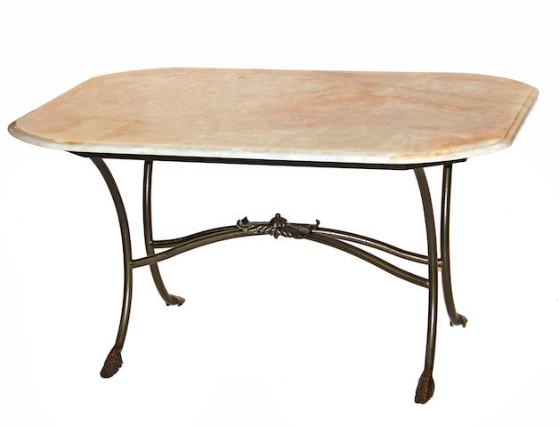 A contemporary cast iron and onyx dining table