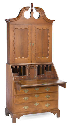 A Chippendale cherry secretary bookcase <BR />New England <BR />18th century