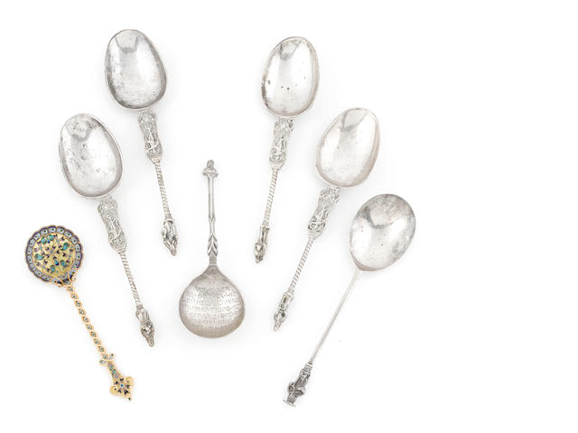 An assembled group of Continental and English silver and enamel spoons 18th / 20th century