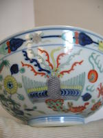 A wucai enameled dragon and phoenix bowl Guangxu mark and period
