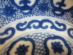 A pair of blue and white porcelain bowls with ruyi lappet decoration Daoguang Marks and Period