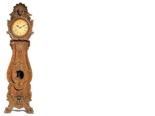 A Continental Baroque style oak tall case clock