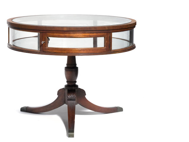 A George III style mahogany and glass vitrine drum table
