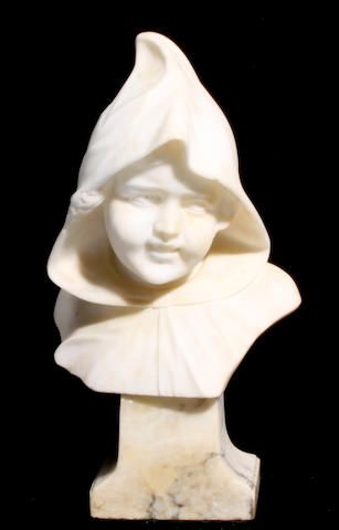 A carved alabaster bust of a child