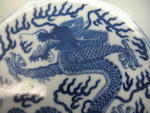 A blue and white porcelain dragon dish Jiaqing mark and period