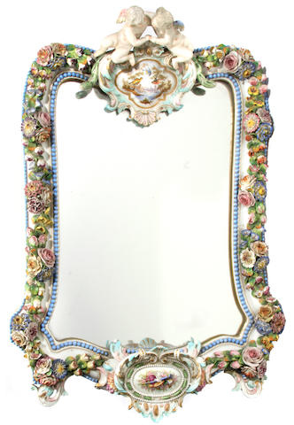 A German Rococo style porcelain mirror
