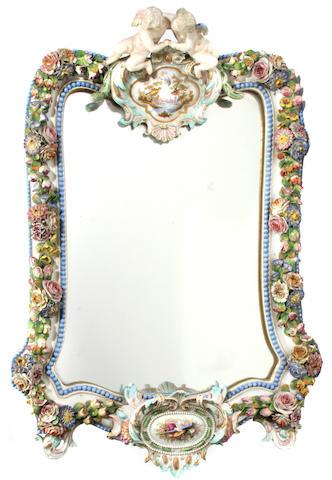 A Meissen style porcelain mirror
