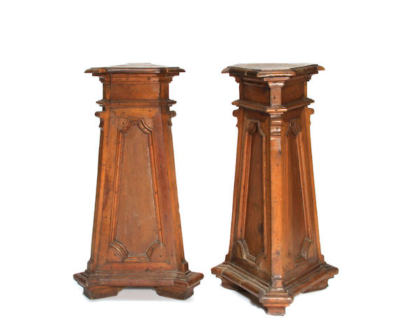 A pair of Italian Baroque style of walnut pedestals
