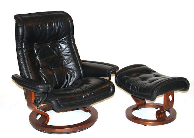 A  Contemporary black leather chair and ottoman