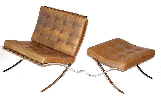 A pair of Ludwig Mies van der Rohe Barcelona chairs and ottoman