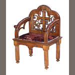 A Gothic style carved oak armchair early 20th century