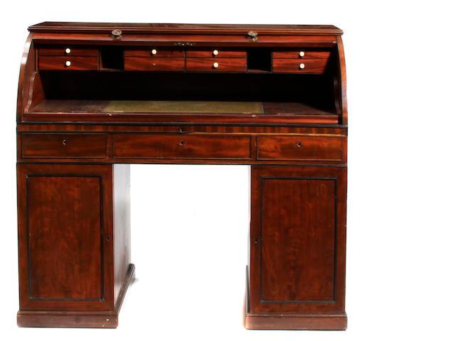 A George IV mahogany cylinder desk