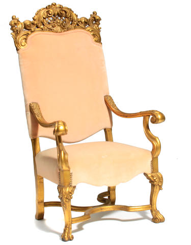 A Continental Baroque style giltwood fauteuil