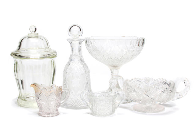 A large collection of pressed, molded and cut clear glass table articles