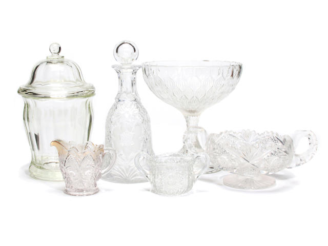 A large collection of pressed, molded, and cut clear glass table articles