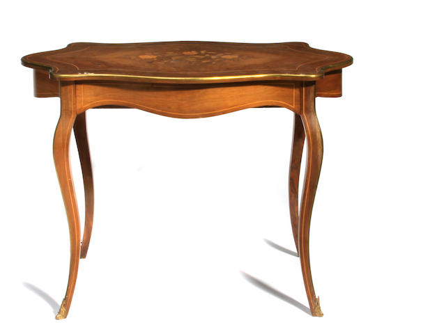 A Louis XV style gilt bronze mounted marquetry inlaid walnut center table