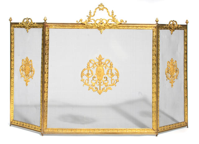A pair of Baroque style andirons together with a gilt metal mounted firescreen