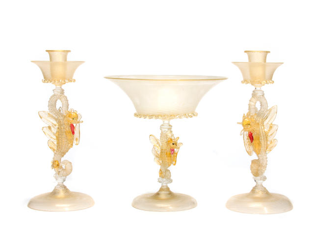 A Venetian glass centerpiece together with a pair of candlesticks