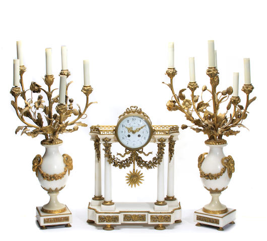 A Louis XVI style marble and gilt bronze mounted clock garniture
