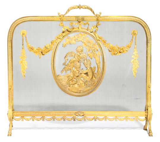 A Louis XVI style gilt bronze firescreen
