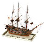 A Napoleonic prisoner-of-war boxwood model of a 112 gun first rate ship of the line<BR /> circa 1800 15-1/2 x 7-1/4 x 13 in. (39.3 x 18.4 x 33 cm.) length x depth x height.