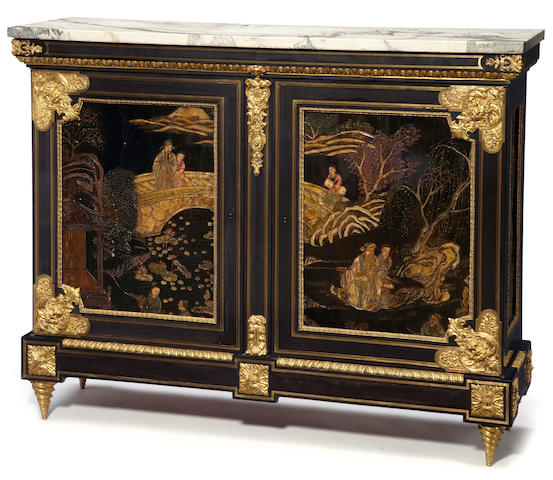 A Louis XIV style gilt bronze and Coromandel lacquer mounted ebonized armoire basse <BR />second half 19th century