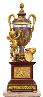 A superb Louis XVI style gilt bronze mounted Griotte Rouge and Fleur de Pêcher marble urn form rotary clock on pedestal <BR />fourth quarter 19th century