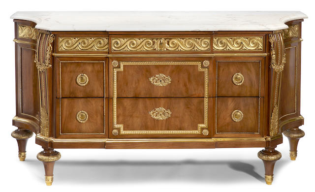 A Louis XVI style gilt bronze mounted walnut commode <BR />fourth quarter 19th century