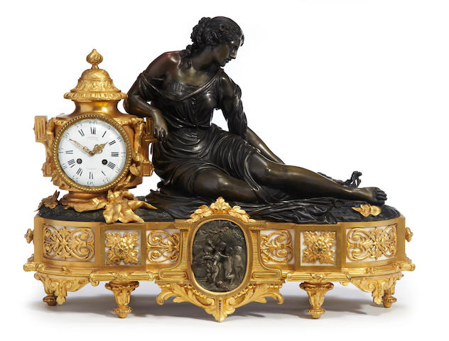 A Louis XVI style gilt and patinated bronze figural mantle clock <BR />Jean-François Denière and Cailleaux<BR />mid-19th century